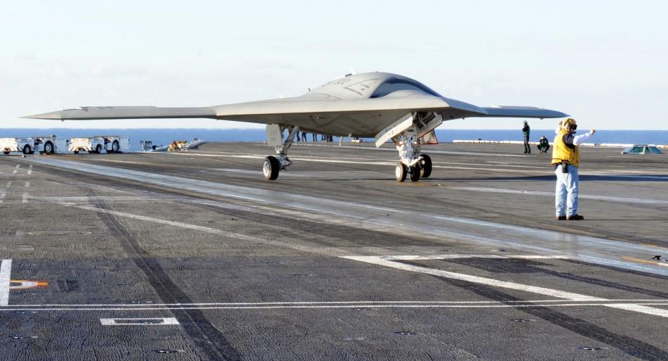 An X-47 B fighter drone aboard the USS Truman ((U.S. Navy/ MC2 David R. Finley Jr)