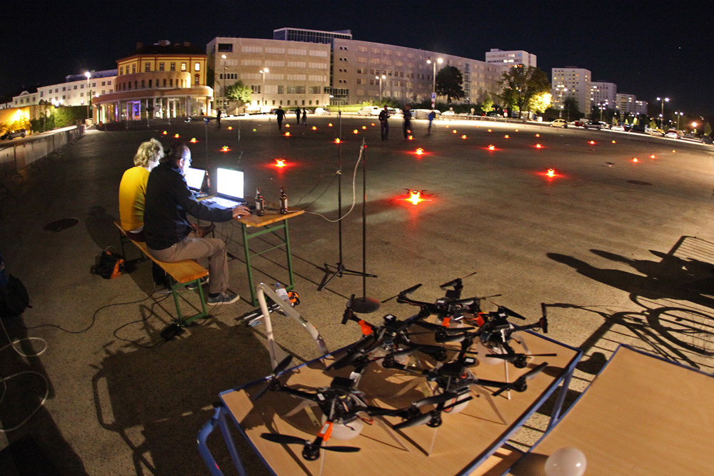 Futurelab technicians prepare drones for an aerial swarming performance.