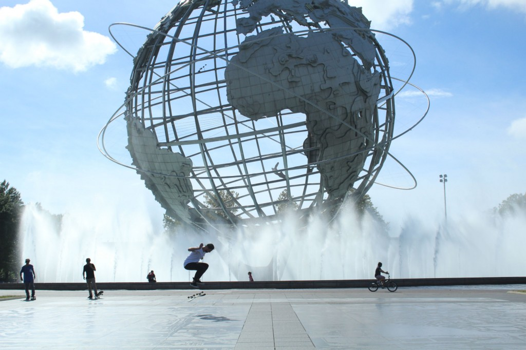 Skateboarders in front of the Unisphere in Flushing Meadows Park, on of the attractions of the 1964. World's Fair.