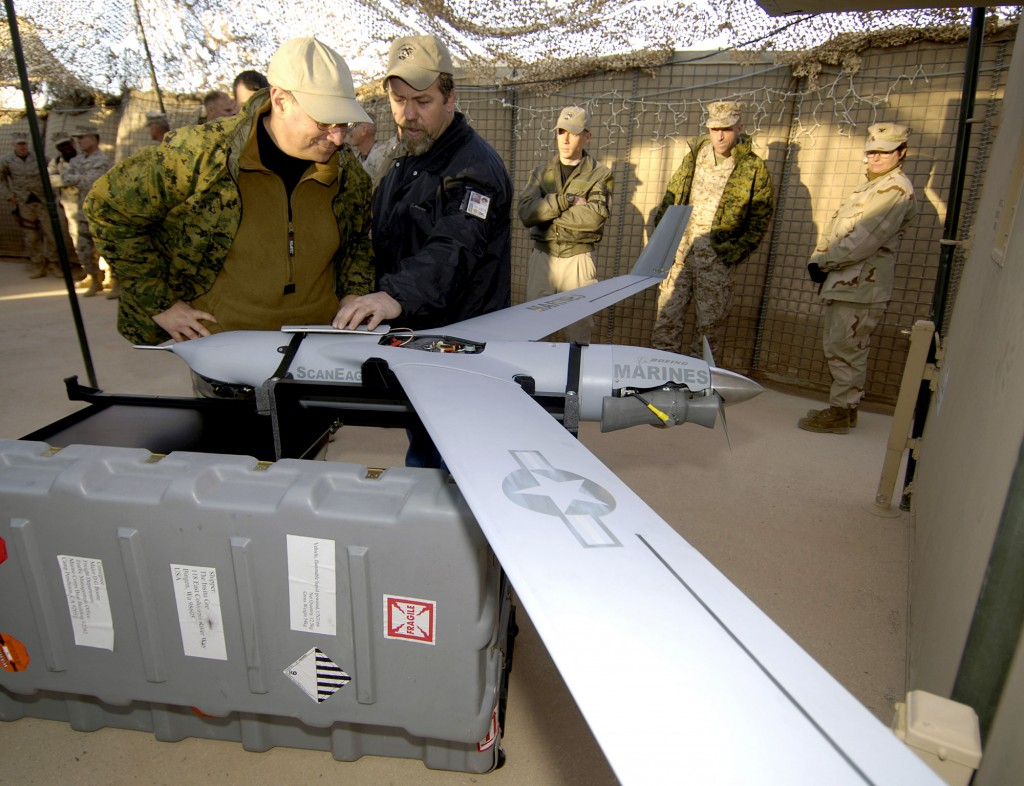 A Boeing contractor working for the Marine Corps explains the ScanEagle to then-Secretary of the Navy Donald C. Winter in 2006. Credit: U.S. Navy photo by Chief Petty Officer Craig P. Strawser