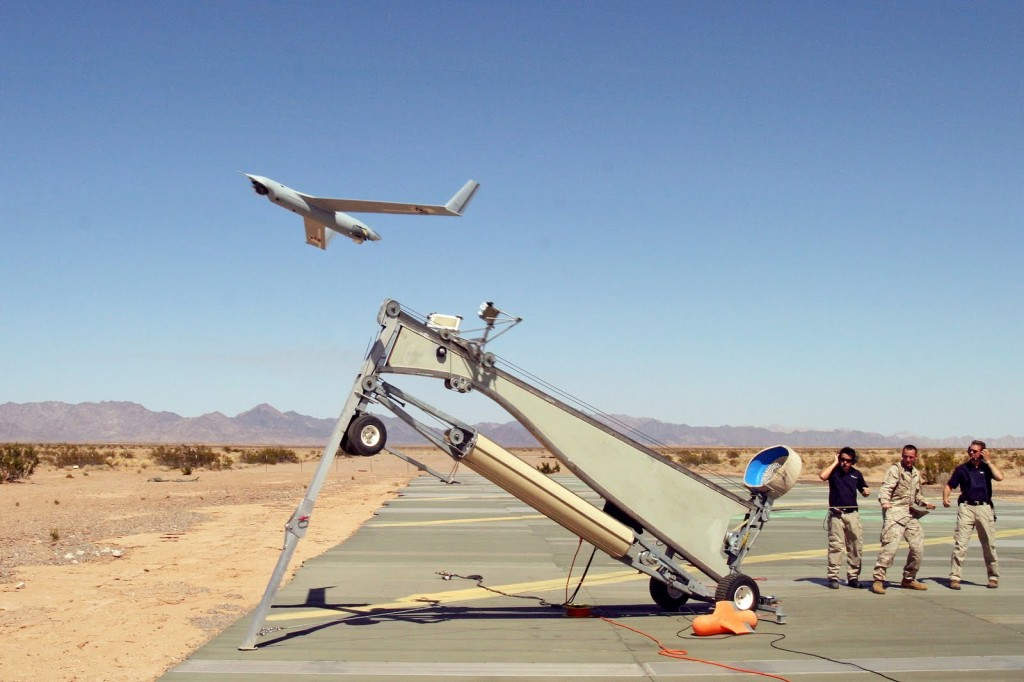 Yuma, Ariz. (June 16, 2006) - U.S. Marine Corps Sgt. Michael Kropiewnicki, a Combat Videographer assigned to 2nd Marine Aircraft Wing (MAW) Combat Camera, launches a Boeing Scan Eagle Unmanned Aerial Vehicle (UAV) during the training exercise Desert Talon 2-06 onboard Marine Corps Air Station (MCAS). Credit: U.S. Marine Corps photo by Sgt Guadalupe M. Deanda III