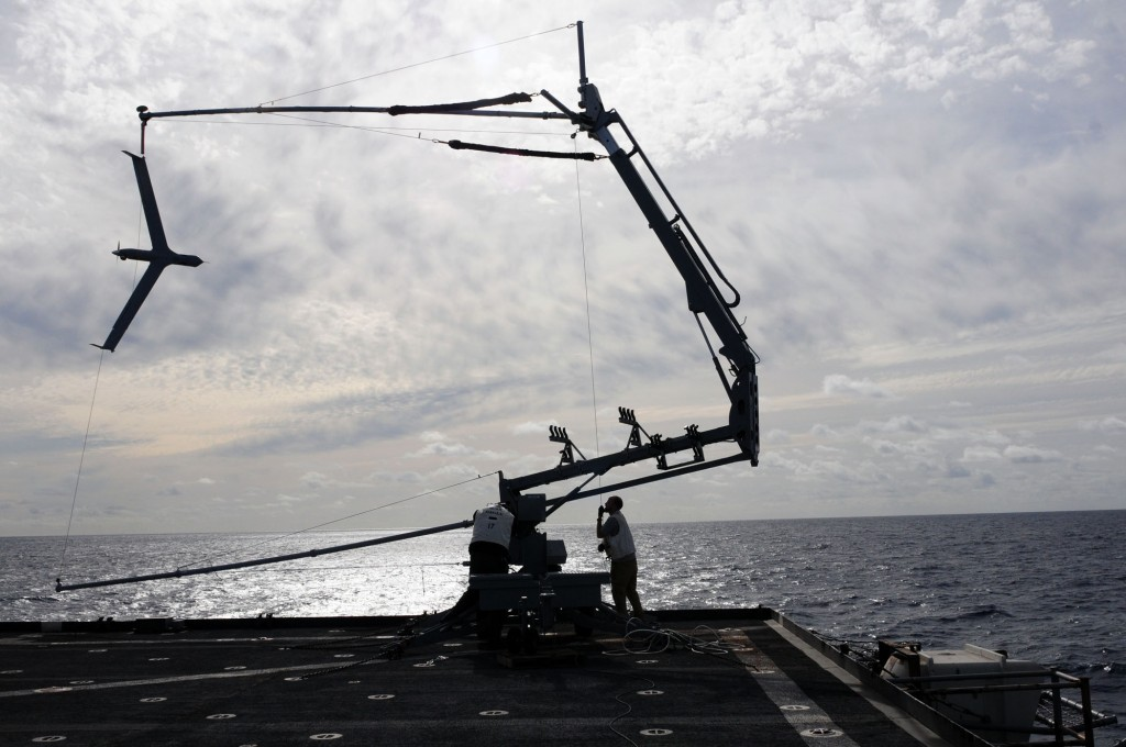 "The ScanEagle is recovered using a ""skyhook,"" which is a rope attached to a 50ft pole. Credit: U.S. Navy photo by Mass Communication Specialist 2nd Class Joseph M. Buliavac/Released"