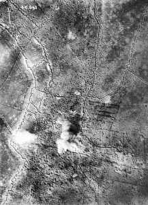 A vertical photograph of Thiepval village, and German front-line and support trenches, while under bombardment by British artillery. Credit: Imperial War Museum