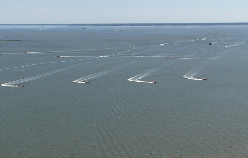 U.S. Navy unmanned surface vehicles operating in swarm maneuvers on the James River in August. Credit: Flickr/ Office of Naval Research.