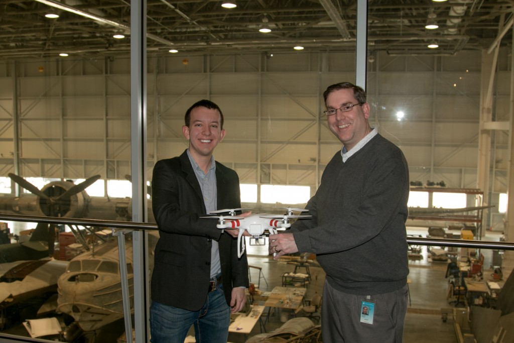 Dan Gettinger hands over the DJI Phantom drone to Roger Connor, curator of the NASM UAV exhibit.