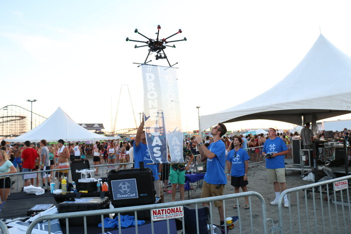 DroneCast, an advertising company, uses drones to fly banners over events and businesses. Credit: DroneCast