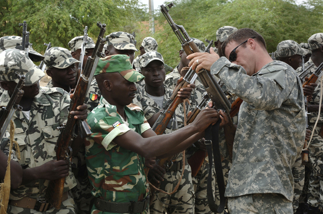 An American advisor training Ethiopian troops. Credit: U.S. Army