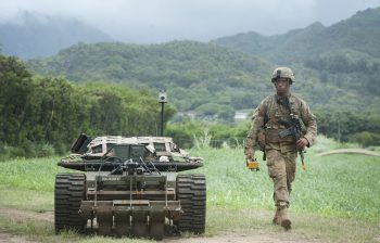 An PACMAN-I unmanned ground vehicle accompanies a U.S. Army solider during the Pacific Manned Unmanned – Initiative on July 22, 2016 inHawaii. Credit: Staff Sgt. Christopher Hubenthal/U.S. Air Force