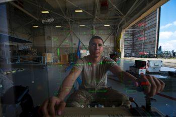 An Air Force airman at the control module of an MQ-9 Reaper. Credit: John Bainter/USAF
